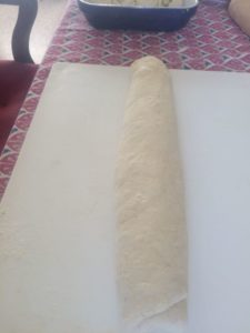 Cylinder of dough after it's been rolled around the filling